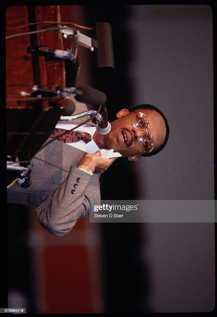 Haitian President Jean-Bertrand Aristide, as he speaks to supporters at a rally, calls on American President George Bush for help.
