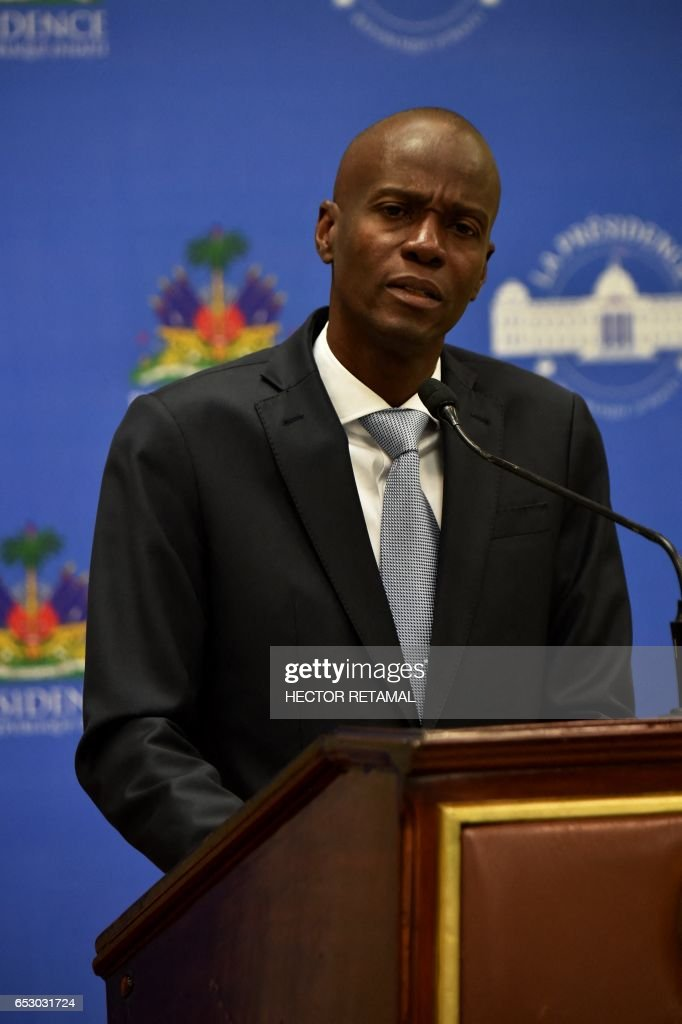 Haitian President Jovenel Moise speaks on March 13, 2017 in Port-au-Prince offering condolences to the families of victims in the road accident that took the lives of 38 persons the previous day in Gonaives. A bus speeding away from a hit-and-run accident plowed into dozens of street musicians in northern Haiti, killing 38 people, officials said. /