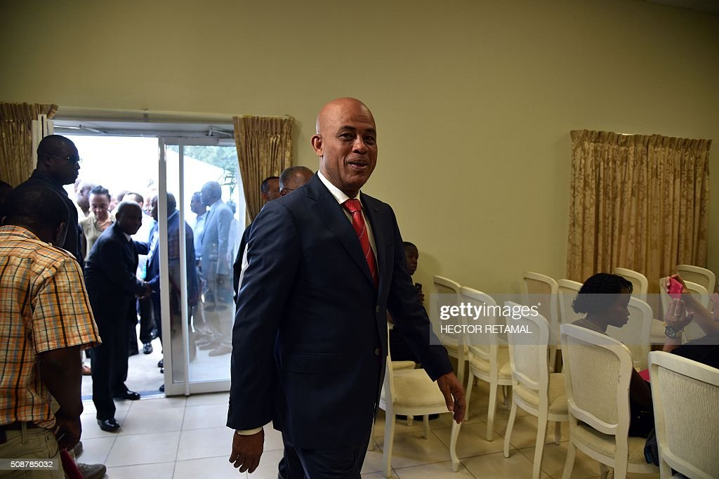 Haitian President Michel Martelly arrives to sign the agreement installing a transitional government on February 6, 2016 in Port-au-Prince, Haiti. Haitian politicians inked a last-minute agreement to install a transitional government, just hours before President Michel Martelly was scheduled to step down with no replacement in line. / AFP / HECTOR RETAMAL