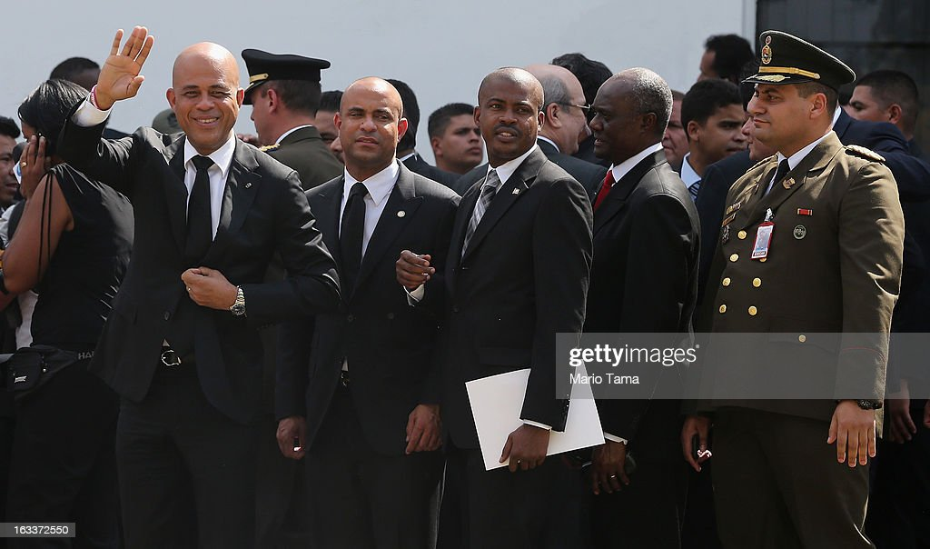 Haitian President Michel Martelly (L) waves to the crowd while departing the funeral for Venezuelan President Hugo Chavez at the Military Academy on March 8, 2013 in Caracas, Venezuela. Countless Venezuelans have paid their last respects to Chavez and more than 30 heads of state were expected to attend the funeral today.