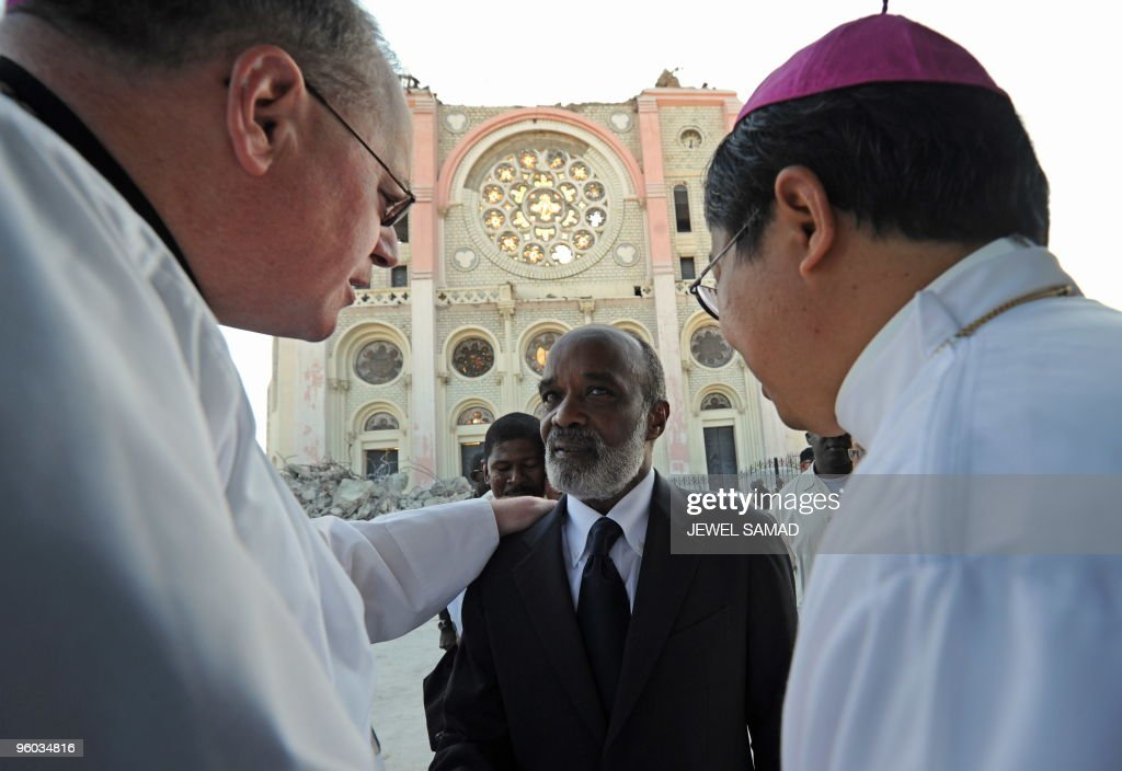 Haitian President Rene Preval (C) is greeted by US Archbishop Timothy Dolan (L) before the funeral of Haitian Archbishopo Joseph Serge Miot killed in last week's devastating earthquake outside Notre Dame d'Assumption Cathedral in Port-au-Prince on January 23, 2010. More than 110,000 people have been confirmed as killed in Haiti's devastating earthquake, the Interior Ministry said, making it the deadliest on record in the Americas. AFP PHOTO / JEWEL SAMAD