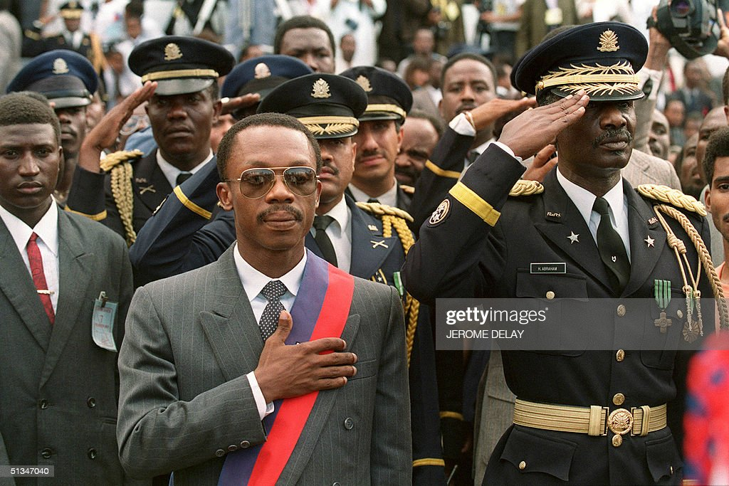 Haitian Presidentelect JeanBertrand Aristide who won 16 December 1990 elections flanked by Haitian Armed forces Commander General Herard Abraham...