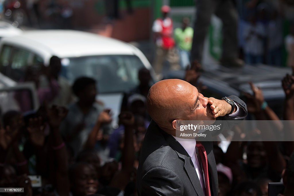 Haitian president-elect <a gi-track='captionPersonalityLinkClicked' href=/galleries/search?phrase=Michel+Martelly&family=editorial&specificpeople=7130974 ng-click='$event.stopPropagation()'>Michel Martelly</a> greets supporters while returning to his car after a press conference the morning after the preliminary results of the campaign were announced April 5, 2011 in Port-au-Prince, Haiti. Martelly took 67 percent of the vote against former first lady Mirlande Manigat.