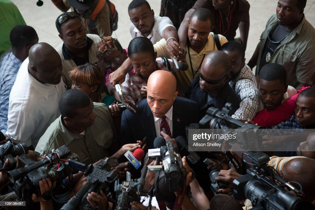 Haitian presidential candidate <a gi-track='captionPersonalityLinkClicked' href=/galleries/search?phrase=Michel+Martelly&family=editorial&specificpeople=7130974 ng-click='$event.stopPropagation()'>Michel Martelly</a> speaks to the press as members of the Interim Haiti Recovery Commission meet with Haitian presidential candidates to discuss the work of the commission after the change of political administration at the Hotel Karibe February 15, 2011 in Port-au-Prince, Haiti. Former U.S. President Bill Clinton discussed the future efforts to reconstruct the nation with presidential candidates Michel 'Sweet Micky' Martelly and former first lady Mirlande Manigat, who will compete in a March 20 runoff.