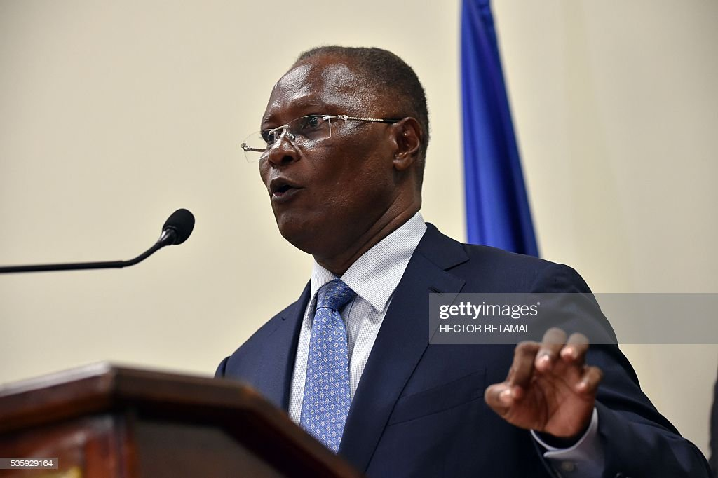 Haitian Provisional President Jocelerme Privert speaks after receiving a special commission's investigative report on the 2015 Haitian election at the National Palace in Port-au-Prince, on May 30, 2016. The commission proposes rerunning the presidential election of 2015. / AFP / HECTOR