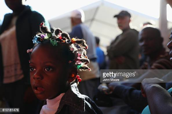 Haitian refugee look waits for breakfast at an immigrant center on September 24 2016 in Tijuana Mexico In recent months a surge of Haitian refugees...