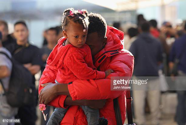 Haitian refugees await breakfast at an immigrant center on September 24 2016 in Tijuana Mexico In recent months a surge of Haitian refugees has...