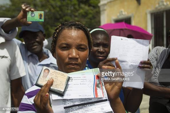 Haitian sugar cane workers rally in front of the Haitian embassy demanding the Haitian passports needed to regularize their migration status in the...