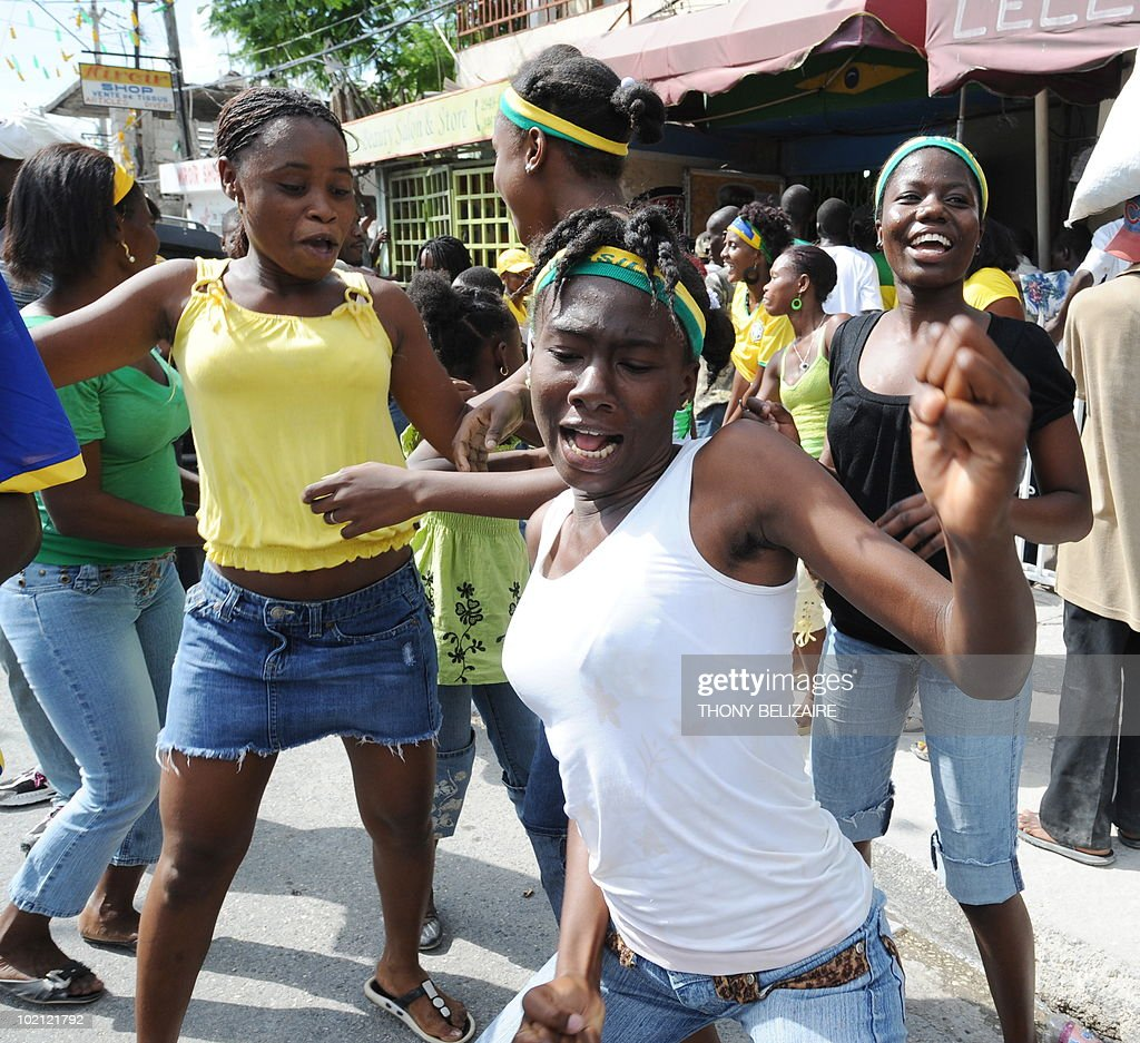 Haitians celebrate on a street June 15, 2010 in Port-au-Prince after watching Brazil's World Cup victory over North Korea on television. Five-time World Cup winners Brazil opened their South Africa 2010 campaign with a workmanlike 2-1 win over Asian minnows North Korea AFP PHOTO / Thony BELIZAIRE