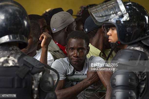 Haitians queue up to legalize their status at the Interior Ministry in Santo Domingo on June 17 2015 Tens of thousands of people are facing...