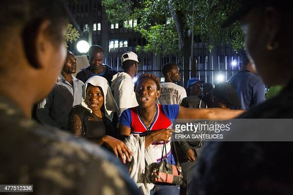 Haitians queueing up to legalize their status at the Interior Ministry show signs of despair at the possibility of being outside the National...