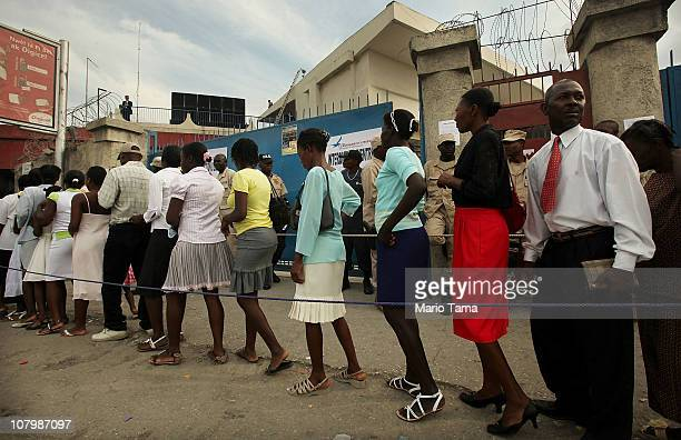 Haitians wait to enter the Festival of Hope rally at the National Stadium led by Franklin Graham son of US Christian evangelist Billy Graham January...