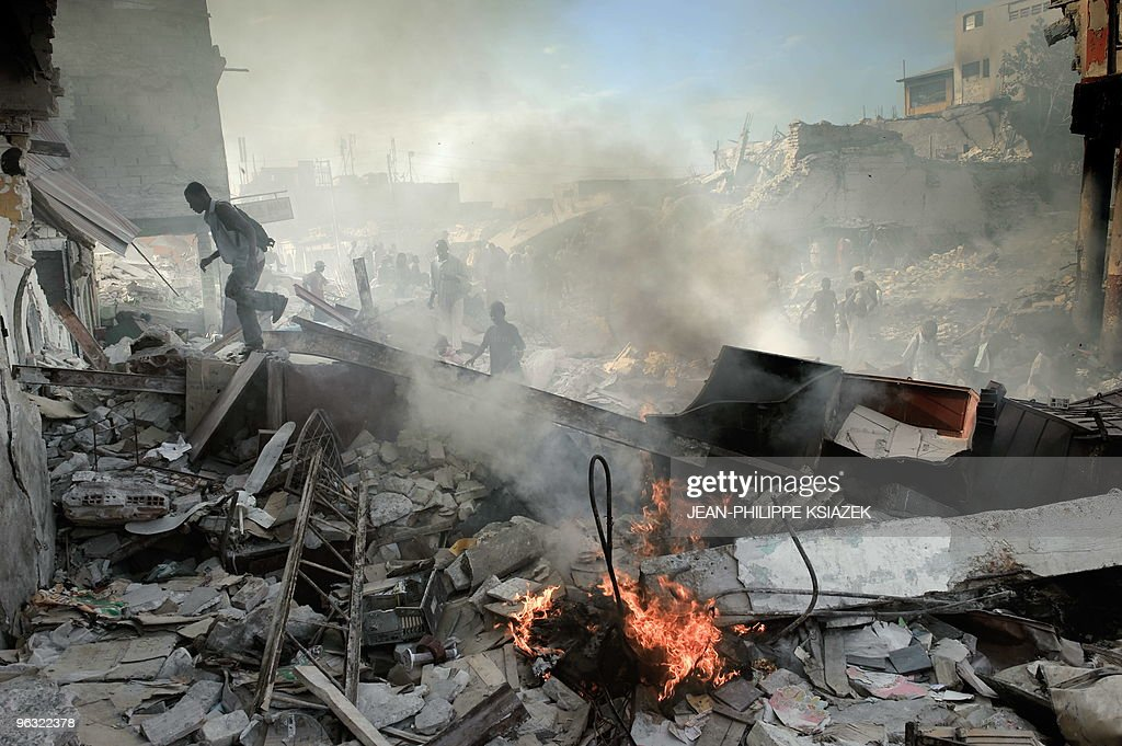 Haitians walk through collapsed buildings near the iron market in PortauPrince on January 31 2010 Quakehit Haiti will need at least a decade of...