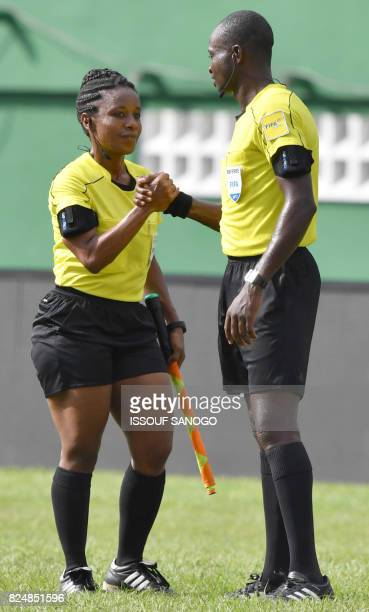 Haiti's referee Louis Wesline shakes hands with a colleague during the semifinal football match between Morroco and the Democratic Republic of Congo...