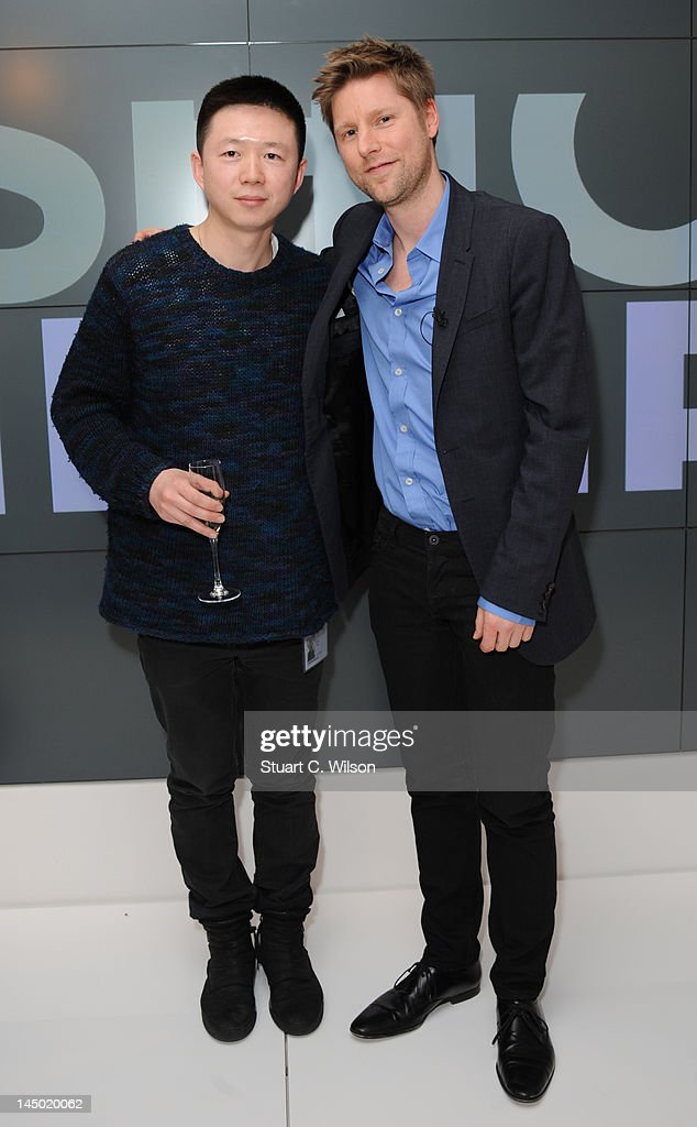 Haizhen Wang and Christopher Bailey attend a photocall to announce the finalist's of Fashion Fringe at Burberry on May 22 2012 in London England