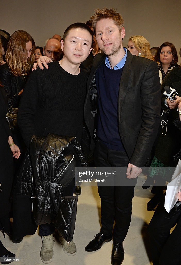 Haizhen Wang and Christopher Bailey pose backstage after the Burberry Womenswear Autumn/Winter 2014 show at Kensington Gardens on February 17 2014 in...