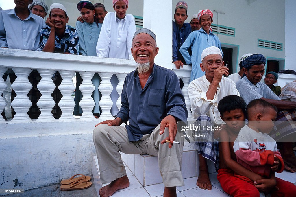 Haji Adam bin Ali, the Hakem of Prey Pres village, talks about Islam, terrorism and the United States, on the steps of his mosque following Friday noon prayers. A Hakem is a village religious leader, similar to an Imam..