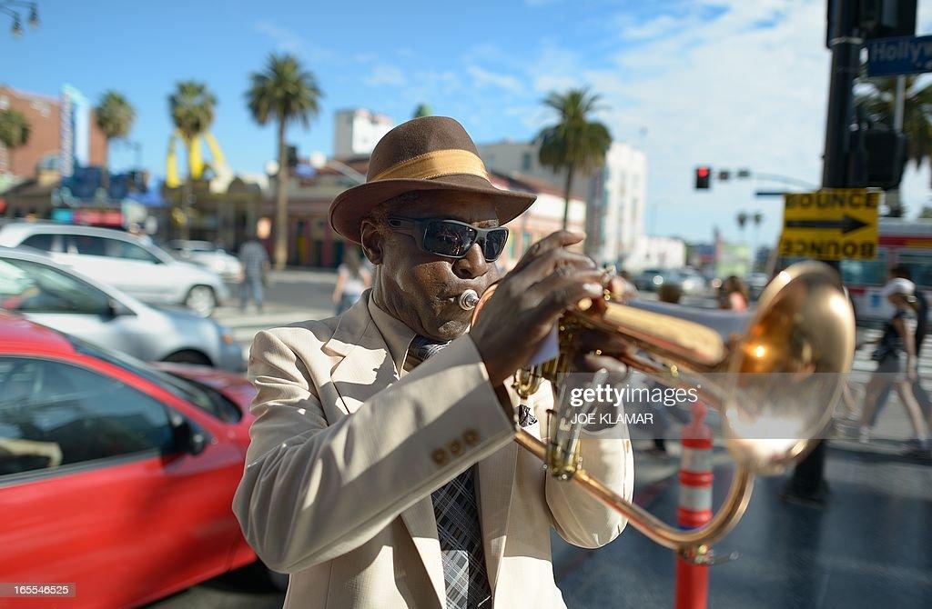 Haji Ahkba, founder and member of The Haji Ahkba Jazz Assembly, plays his trumpet at the intersection of Hollywood Boulevard and North Highland Street on April 04, 2013 in Hollywood,California. KLAMAR