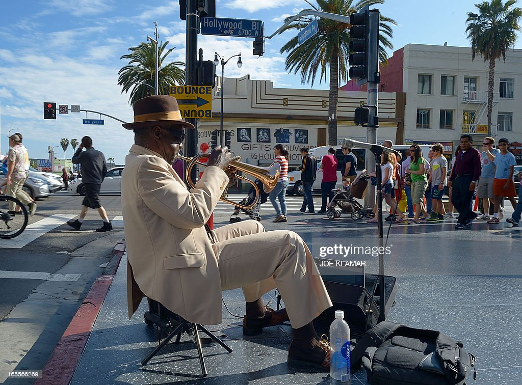 Haji Ahkba, founder and member of The Haji Ahkba Jazz Assembly, plays his trumpet at the intersection of Hollywood Boulevard and North Highland Street on April 04, 2013 in Hollywood,California. KLAMAR
