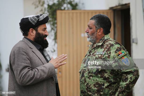 Haji Niyaz Mohammad Amirii provincial governor of Logar Province speaks with Brigadier General Abdul Raziq Safi brigade commander of the Afghan...
