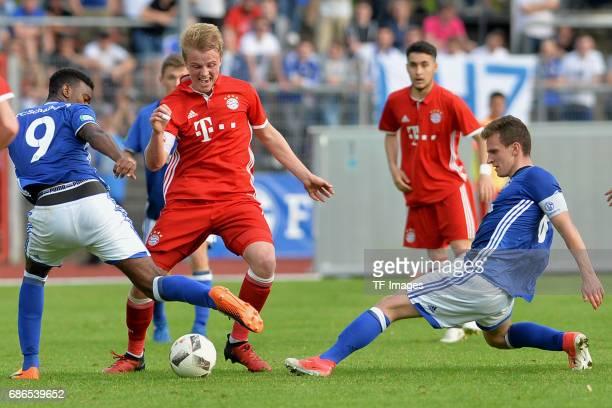Haji Wright of Schalke and Felix Goetze of Munich and Jannis Kuebler of Schalke battle for the ball during the U19 German Championship Semi Final...