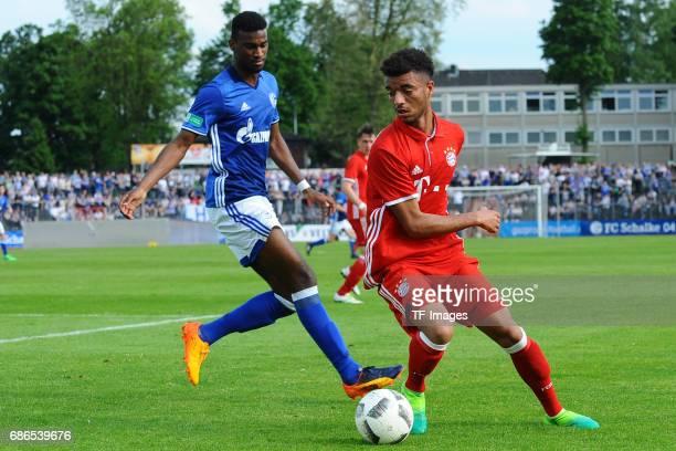 Haji Wright of Schalke and Timothy Tillman of Munich battle for the ball during the U19 German Championship Semi Final second leg match between FC...