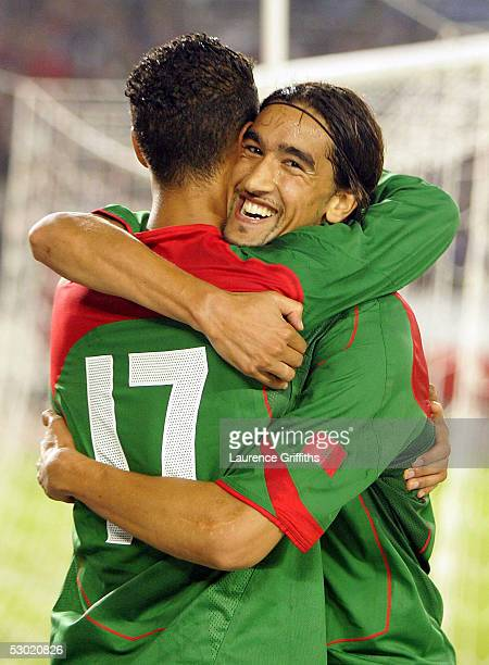 Haji Youssef of Morocco is congratulated on scoring by Chamakh Marouane during The World Cup Qualifying match between Morocco and Malawi at the...