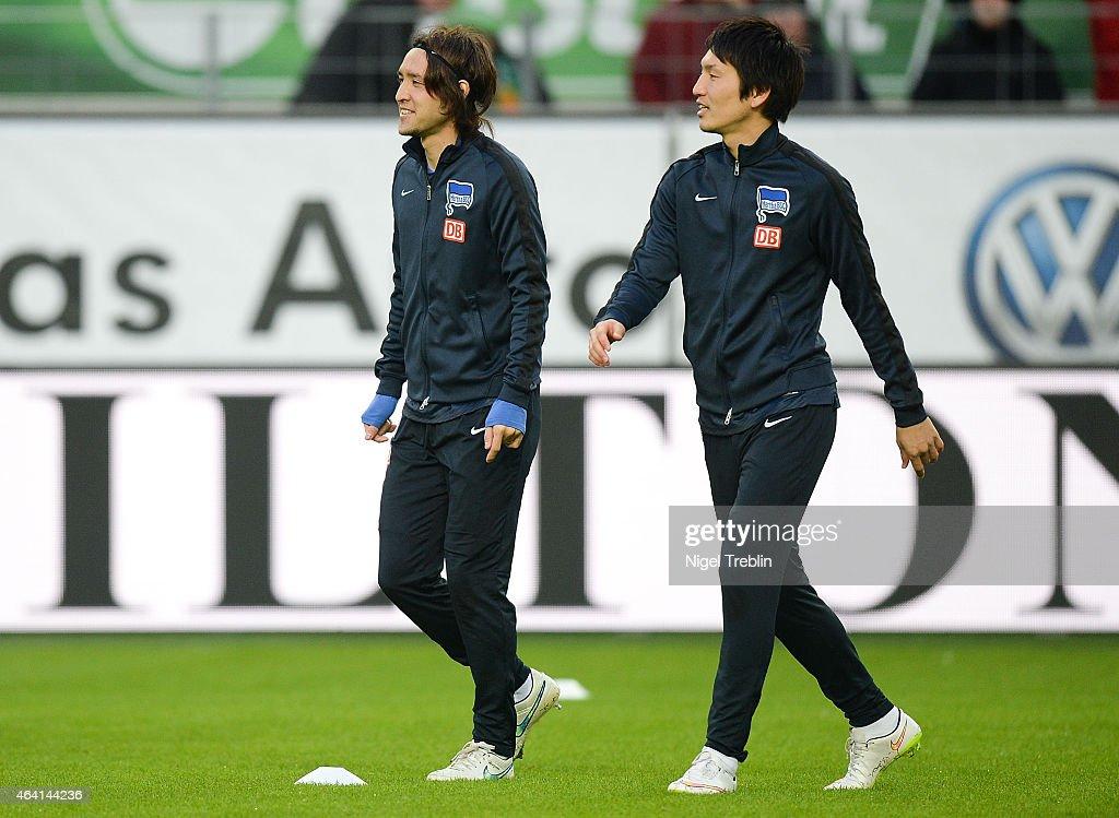 Hajime Hosogai and Genki Haraguchi is pictured prior to the Bundesliga match between VfL Wolfsburg and Hertha BSC Berlin at Volkswagen Arena on...