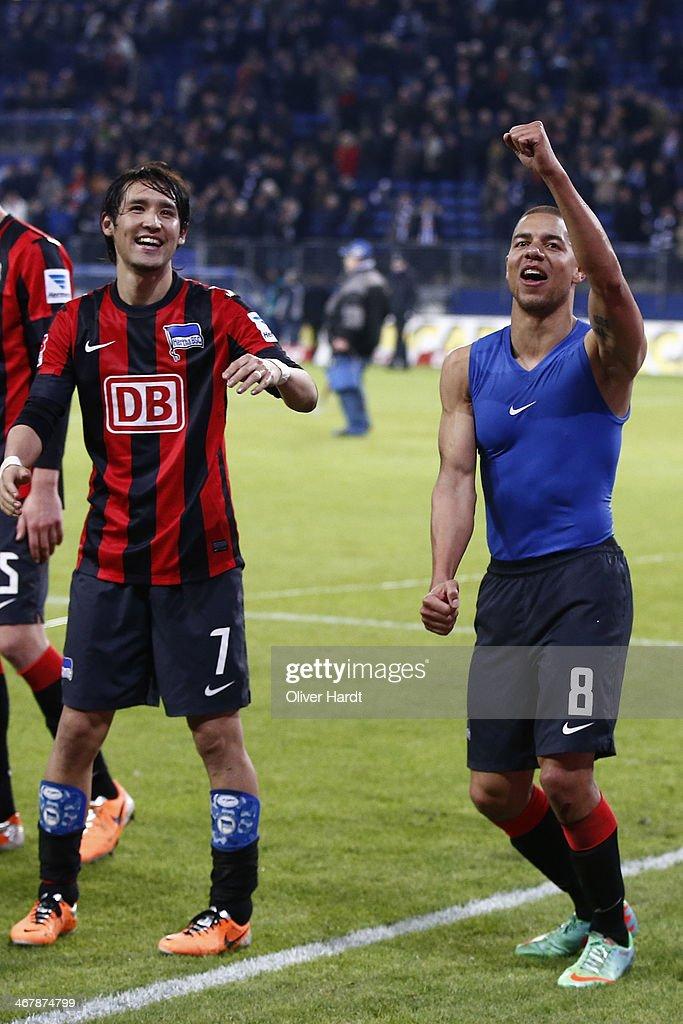 Hajime Hosogai and Marcel Ndjeng of Berlin celebrates after the Bundesliga match between Hamburger SV and Hertha BSC at Imtech Arena on February 8...