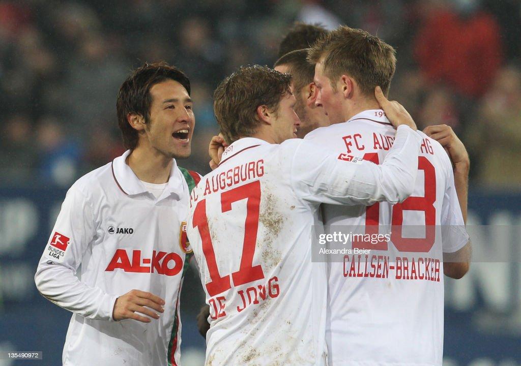Hajime Hosogai Marcel De Jong and JanIngwer CallsenBracker of Augsburg celebrate their first goal during the Bundesliga match between FC Augsburg and...