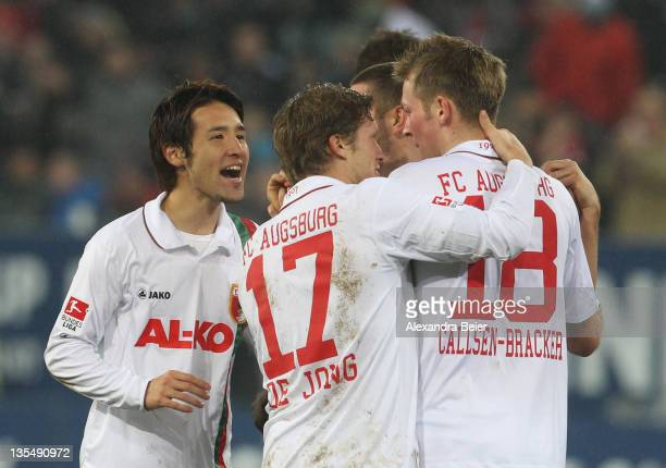Hajime Hosogai Marcel De Jong and JanIngwer CallsenBracker of Augsburg celebrate their first goal during the Bundesliga match between FC Augsburg and...