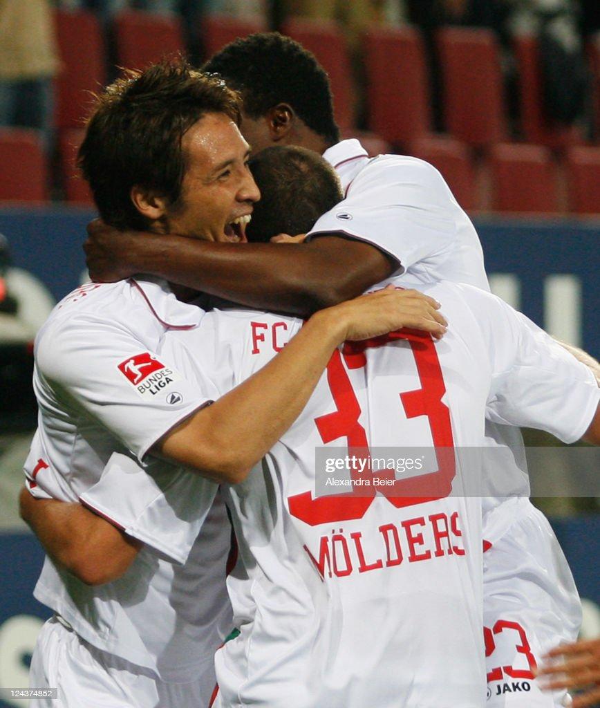 Hajime Hosogai of Augsburg celebrates his first goal together with teammates during the Bundelsliga match between FC Augsburg and Bayer 04 Leverkusen...