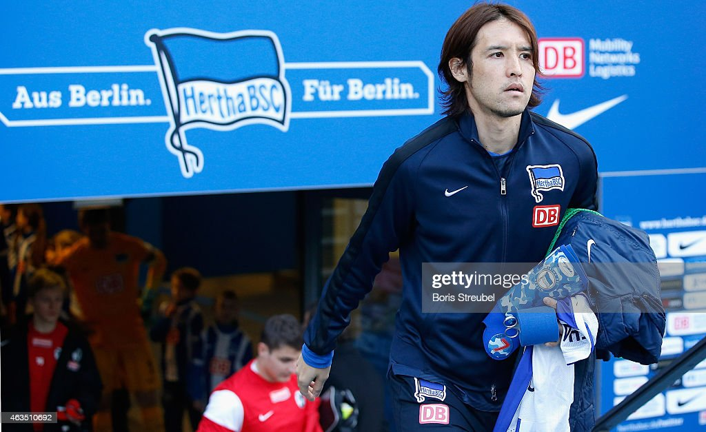 Hajime Hosogai of Berlin enters the pitch prior to the Bundesliga match between Hertha BSC and SC Freiburg at Olympiastadion on February 15 2015 in...