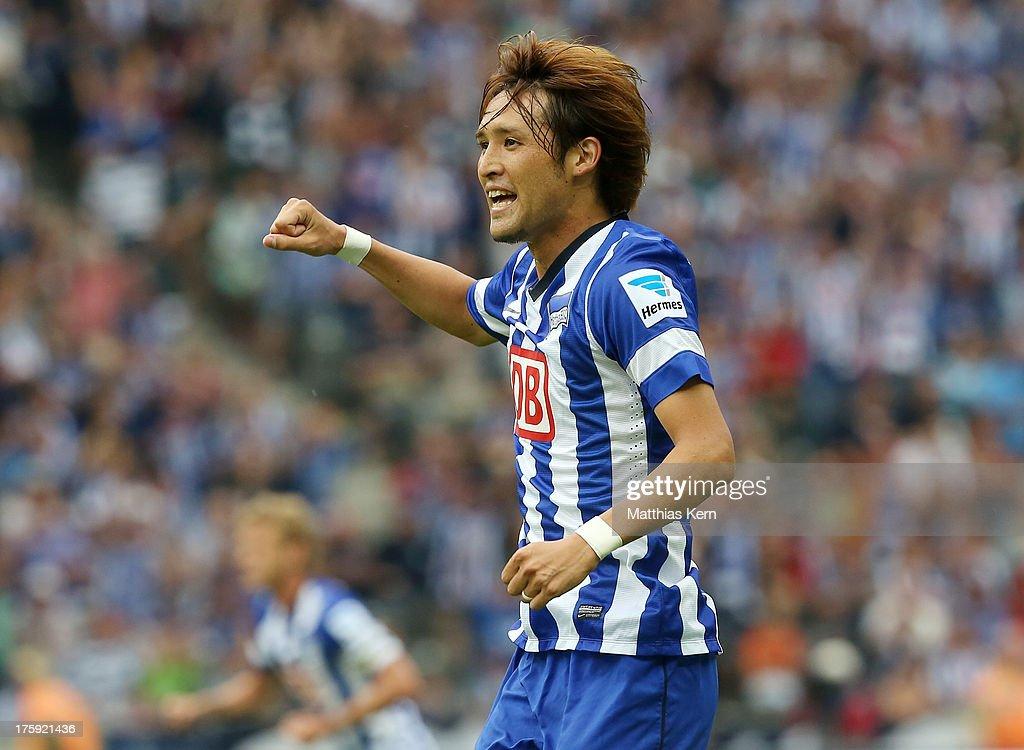 Hajime Hosogai of Berlin jubilates after team mate Sami Allagui scoring the fourth goal during the Bundesliga match between Hertha BSC Berlin and...