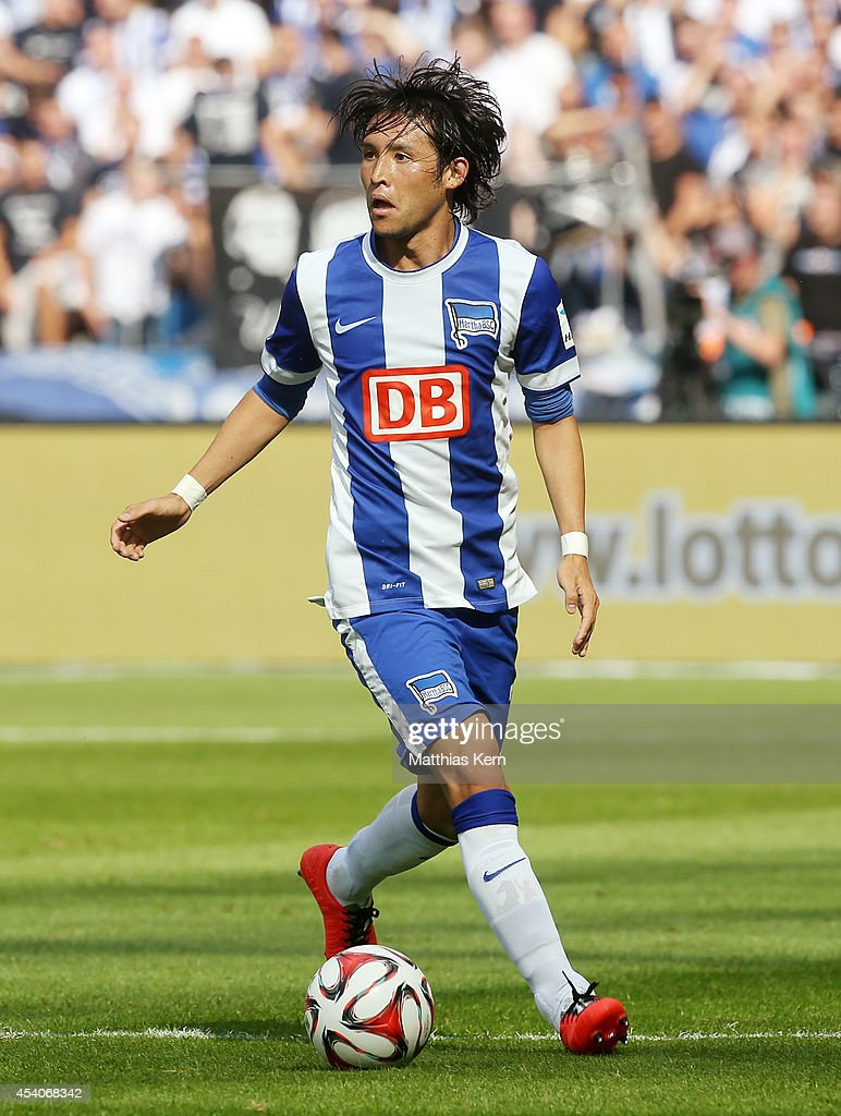 Hajime Hosogai of Berlin runs with the ball during the Bundesliga match between Hertha BSC and SV Werder Bremen at Olympiastadion on August 23 2014...