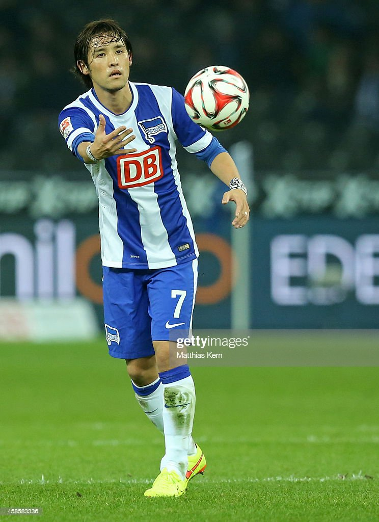 Hajime Hosogai of Berlin throws the ball during the Bundesliga match between Hertha BSC and Hannover 96 at Olympiastadion on November 7 2014 in...