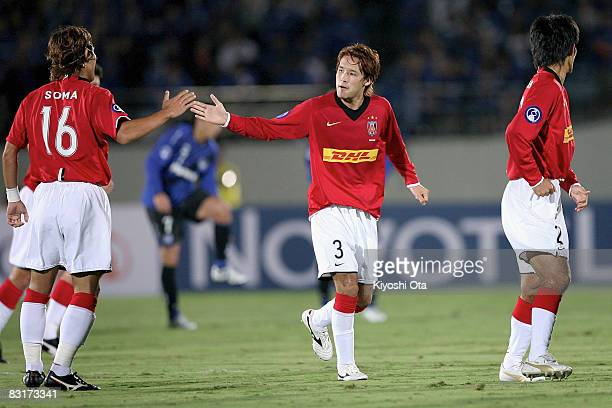 Hajime Hosogai of Urawa Red Diamonds celebrates his goal against Gamba Osaka with his teammate Takahito Soma during the AFC Champions League...