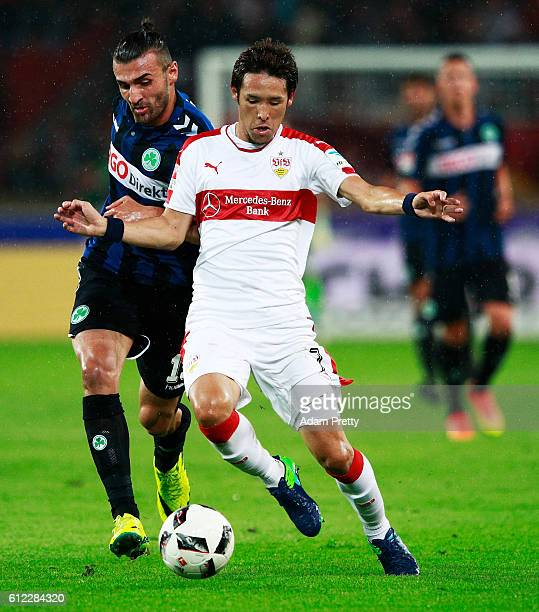 Hajime Hosogai of VfB Stuttgart is tackled by Serdar Dursun of SpVgg Greuther Fuerth before the Second Bundesliga match between VfB Stuttgart and...
