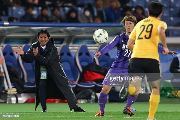 Hajime Moriyasu head coach of Sanfrecce Hiroshima speaks to his players during the FIFA Club World Cup 3rd place match between Sanfrecce Hiroshima...