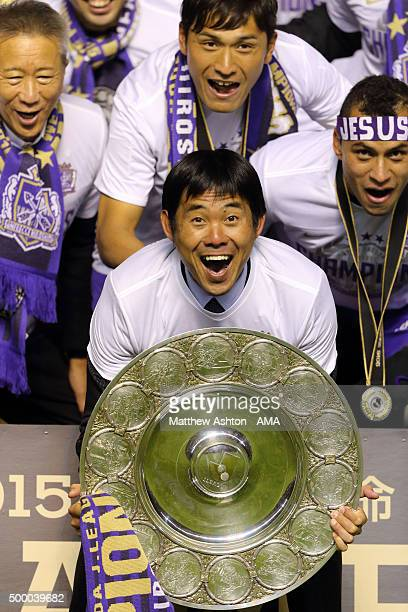 Hajime Moriyasu the head coach / manager of Sanfrecce Hiroshima holds the trophy as he celebrates winning the JLeague 2015 Championship after the...