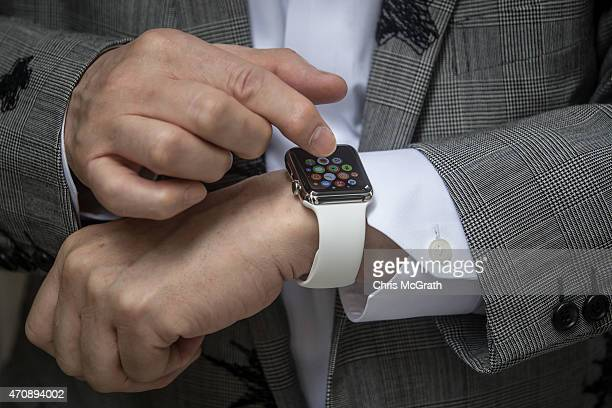 Hajime Shimada shows off his newly purchased Apple Watch outside boutique store Dover Street Market Ginza on April 24 2015 in Tokyo Japan The Apple...