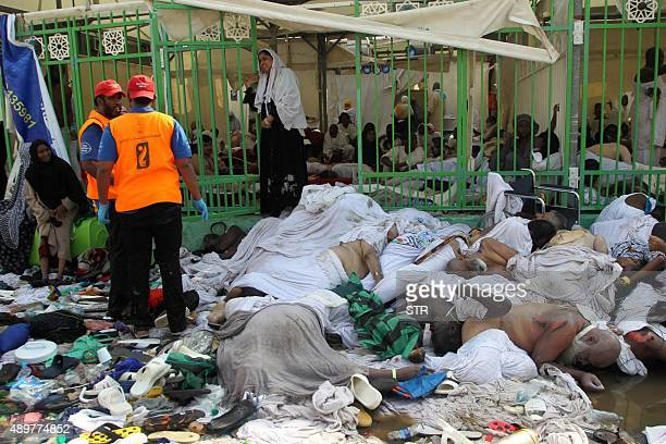 CONTENT Hajj pilgrims and Saudi emergency personnel gather near bodies at the site where at least 717 were killed and hundreds wounded in a stampede...
