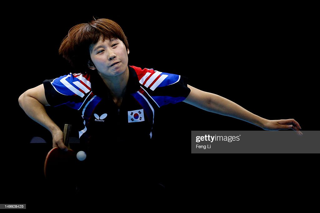 Hajung Seok of Korea competes against Jiawei Li of Singapore during the Women's Team Table Tennis bronze medal match on Day 11 of the London 2012 Olympic Games at ExCeL on August 7, 2012 in London, England.