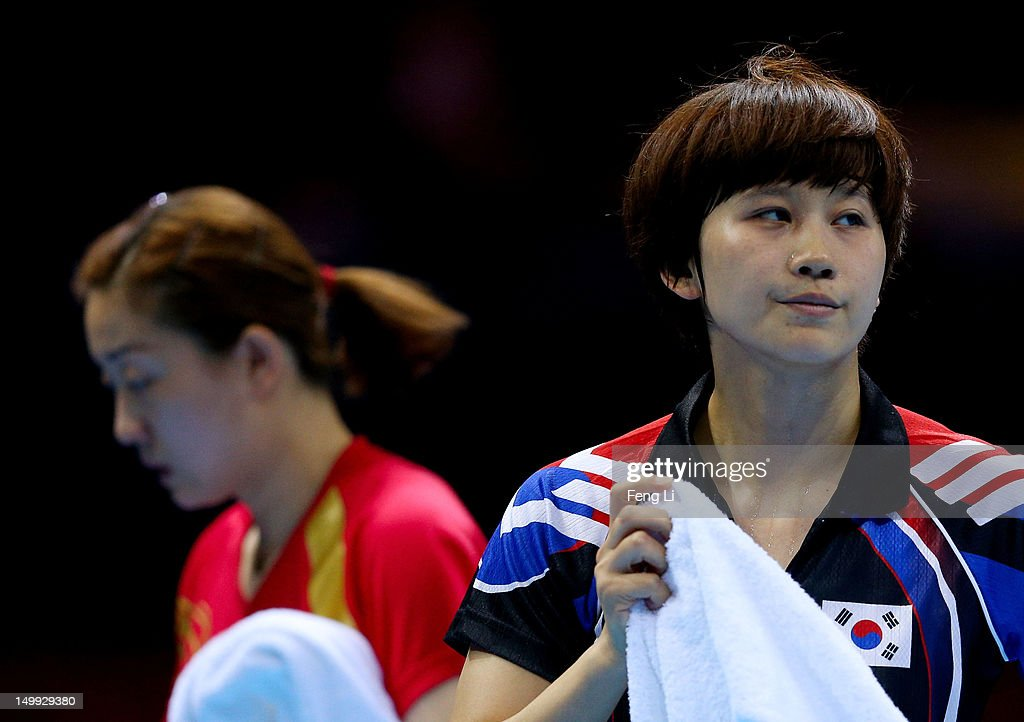 Hajung Seok (R) of Korea walks off after losing 1-3 against Jiawei Li (L) of Singapore during the Women's Team Table Tennis bronze medal match on Day 11 of the London 2012 Olympic Games at ExCeL on August 7, 2012 in London, England.