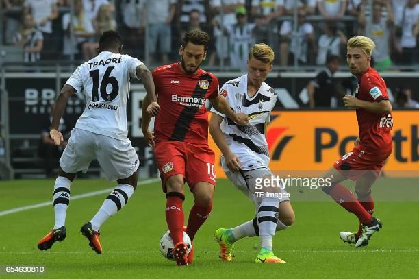 Hakan Çalhanoglu of Leverkusen and Nico Elvedi of Moenchengladbach and Ibrahima Traore of Moenchengladbach and Kevin Kampl of Leverkusen battle for...