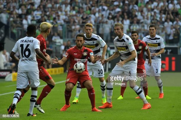 Hakan Çalhanoglu of Leverkusen and Nico Elvedi of Moenchengladbach and Ibrahima Traore of Moenchengladbach and Kevin Kampl of Leverkusen and...