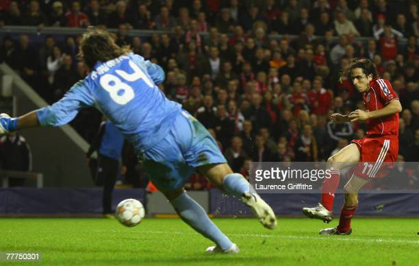 Hakan Arikan of Besiktas is unable to stop Yossi Benayoun of Liverpool scoring his team's third goal during the UEFA Champions League Group A match...