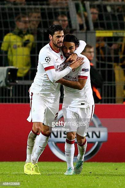 Hakan Balta of Galatasaray is congratulated by teammate Selcuk Inan of Galatasaray after scoring his team's goal during the UEFA Champions League...