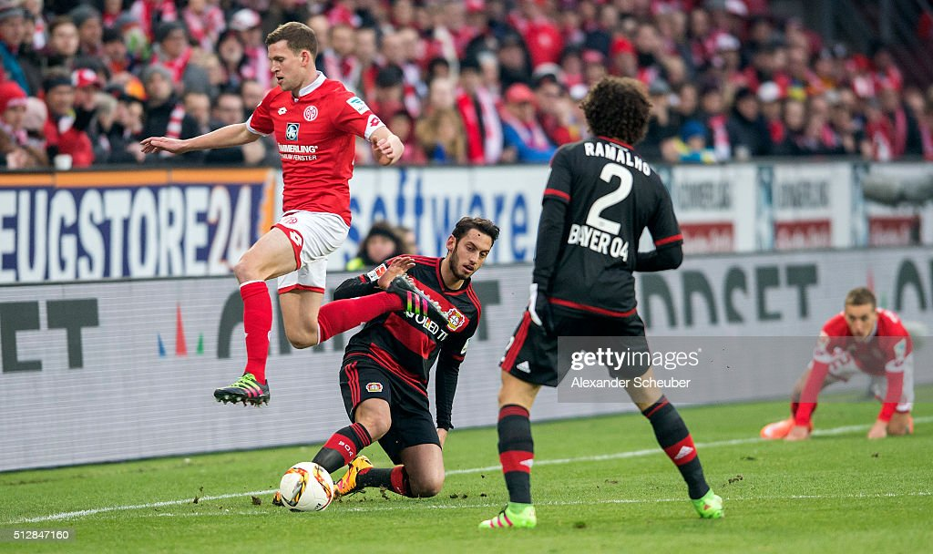 Hakan Calhanhoglu of Bayer Leverkusen challenges <a gi-track='captionPersonalityLinkClicked' href=/galleries/search?phrase=Fabian+Frei&family=editorial&specificpeople=4783637 ng-click='$event.stopPropagation()'>Fabian Frei</a> of 1. FSV Mainz 05 during the Bundesliga match between 1. FSV Mainz 05 and Bayer Leverkusen at Coface Arena on February 28, 2016 in Mainz, Germany.