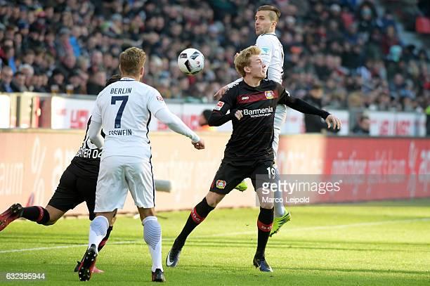 Hakan Calhanoglu Alexander Esswein Julian Brandt of Bayer 04 Leverkusen and Peter Pekarik of Hertha BSC during the game between Bayer 04 Leverkusen...
